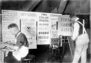 Workers creating signs in the 1920's